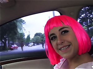 costume play bombshell with pinkish hair deep-throats a massive spear in the front seat of the car