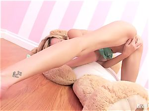 Brett Rossi plays with a jammed bear's strap-on fake penis