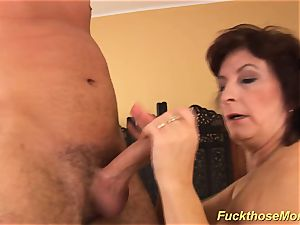 facial cumshot on big-boobed hairy mother