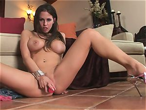 nasty Rachel Roxx slips a giant plaything into her dirty little poon