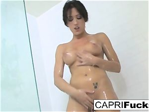 Capri enjoys to finger her cock-squeezing cunt
