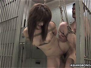 asian sweetheart gets poked with energy behind the planks