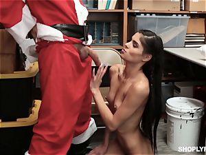 Katya Rodriguez rides on security santas manstick