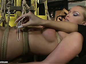 Kathia Nobili and Mandy Bright figure trussing with strap