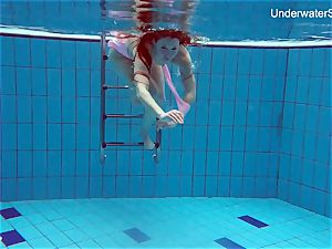 sandy-haired Simonna displaying her figure underwater